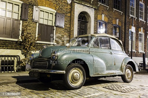 London, UK - June 19, 2016: Morris Minor Convertible car at night. It is a British historical car. More than 1.3 million were manufactured between 1948 and 1972 in three serie