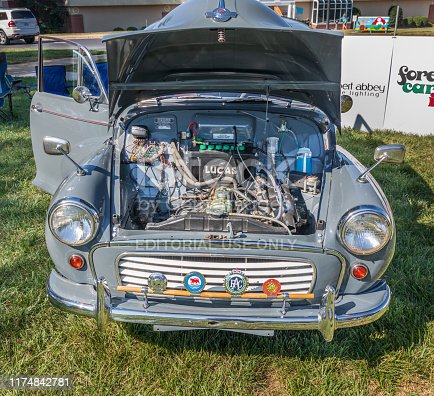 Hickory, NC, USA-7 Sept 2019: 1959 Morris Traveler automobile, grey, woody. Image shows front with engine compartment open.