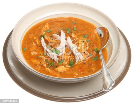 Spicy Morrocan chicken soup garnished with shredded roast chicken.