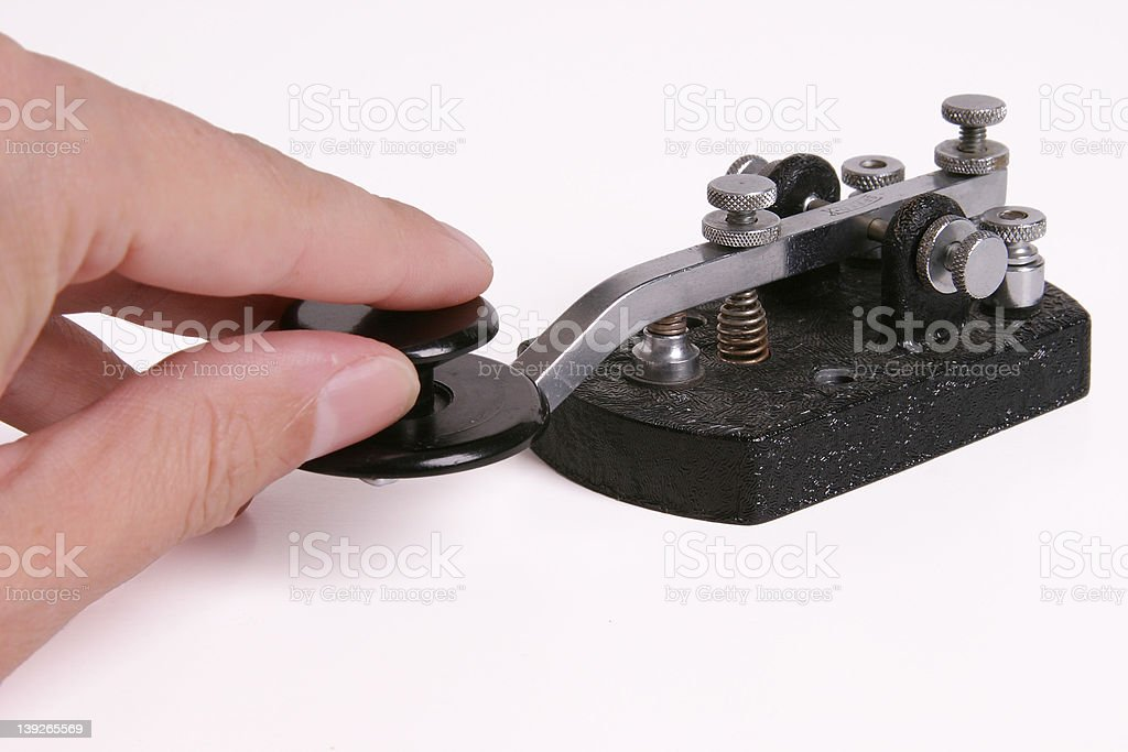 Morse Code Key with hand stock photo