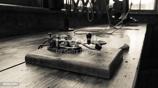 A vintage looking image of a Morse Code & the Telegraph operation clipper use to transmit messages. Antique circa 1920´s. Selective focus. Ideal for themes of communications, obsoleteness and the past.