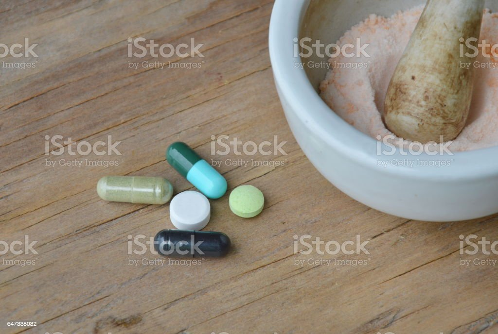mortar and pestle for crushed pill stock photo