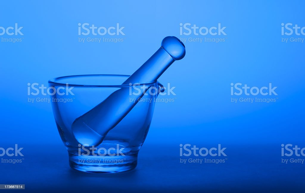 Mortar and Pestle on Blue royalty-free stock photo