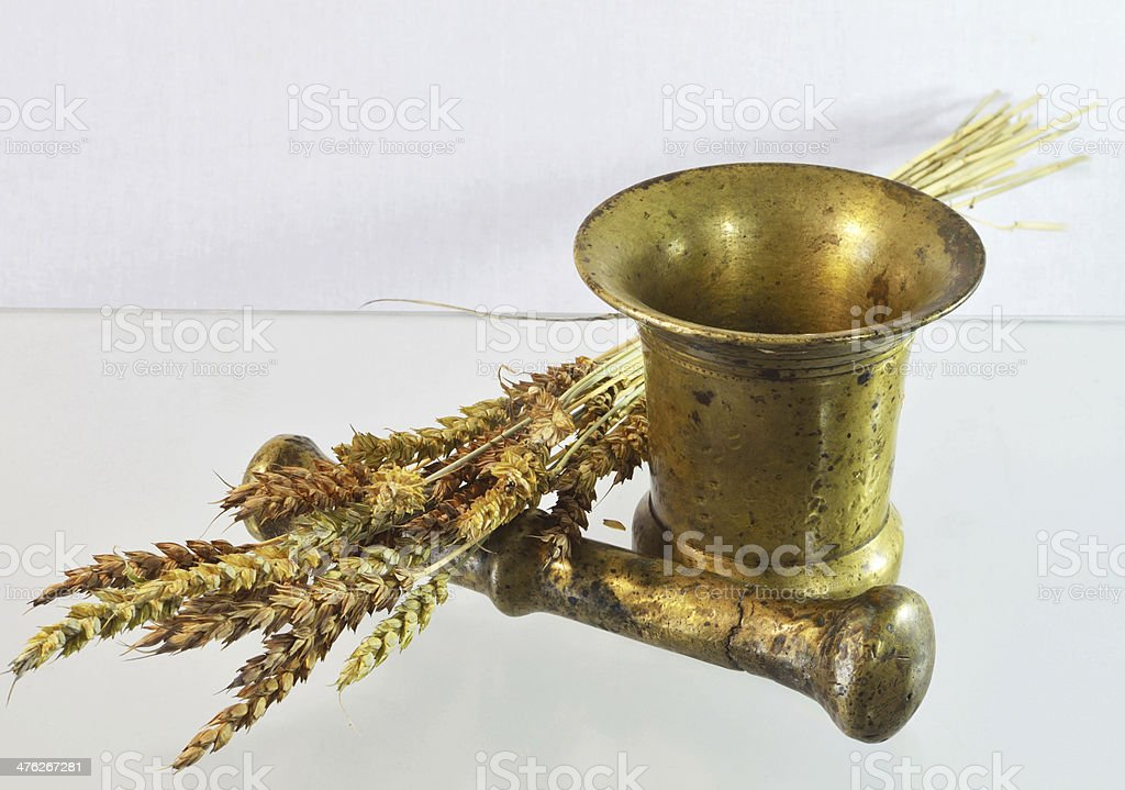 mortar and pestle spikelets royalty-free stock photo