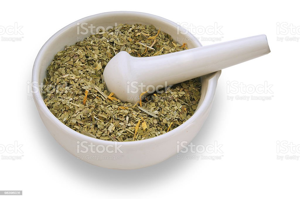mortar and pestle with dry herbs royalty-free stock photo