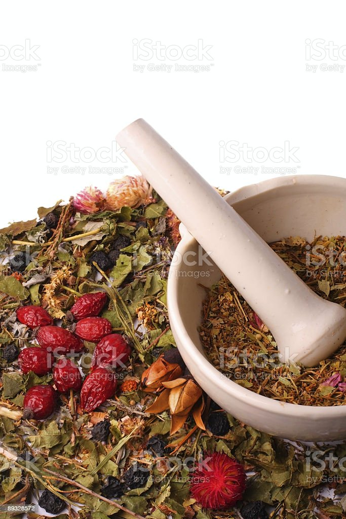 Mortar and pestle with herbs royalty-free stock photo