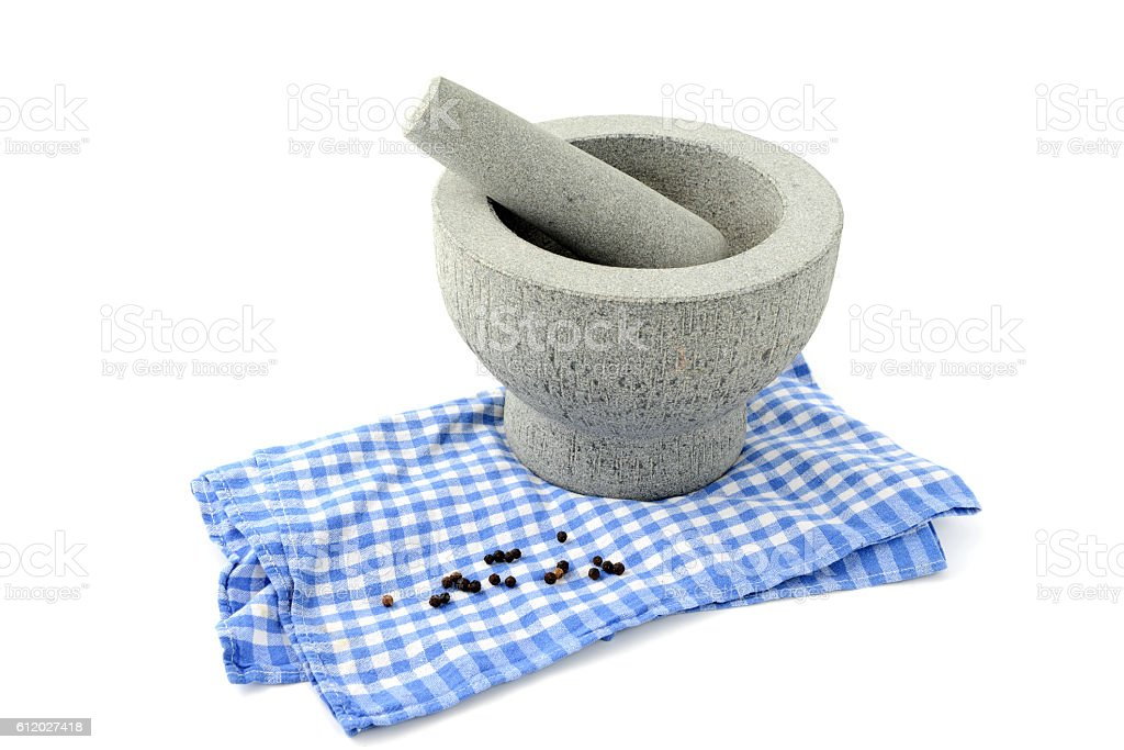 mortar and pestle with pepper on white isolated background stock photo