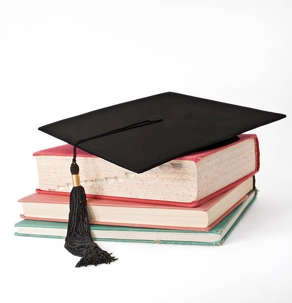 Mortar Board on Old Books - Square stock photo