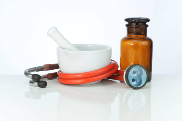 Mortar, stethoscope Mörser, Stethoskop und Apothekerglas spritze stock pictures, royalty-free photos & images