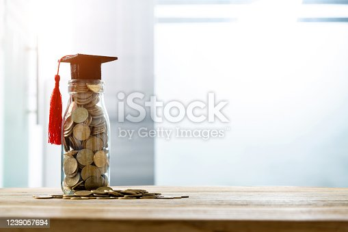 Mortarboard on the coins jar.
