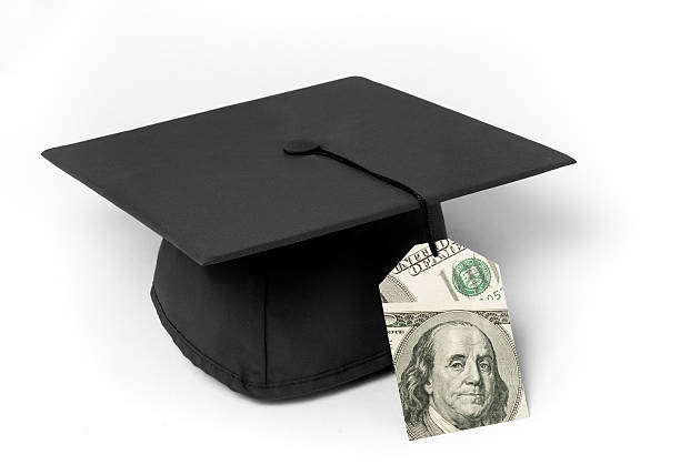 Mortarboard with dollar bill price tag stock photo