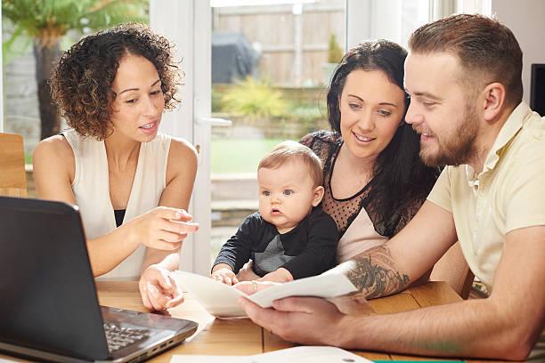 mortgage advisor explaining the small print. - four lawyers stockfoto's en -beelden