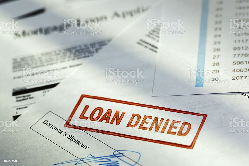 "Mortgage Application Borrower Document with ""Loan Denied"" Red Rubber Stamp royalty-free stock photo"