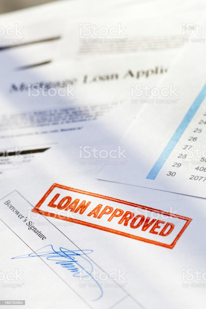 """Mortgage Application Document with Red """"Loan Approved"""" Approval Rubber Stamp stock photo"""