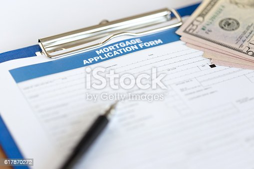 1178695243 istock photo Mortgage Application Form on Desk 617870272