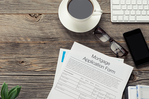istock Mortgage  application form on wooden table. 483890800