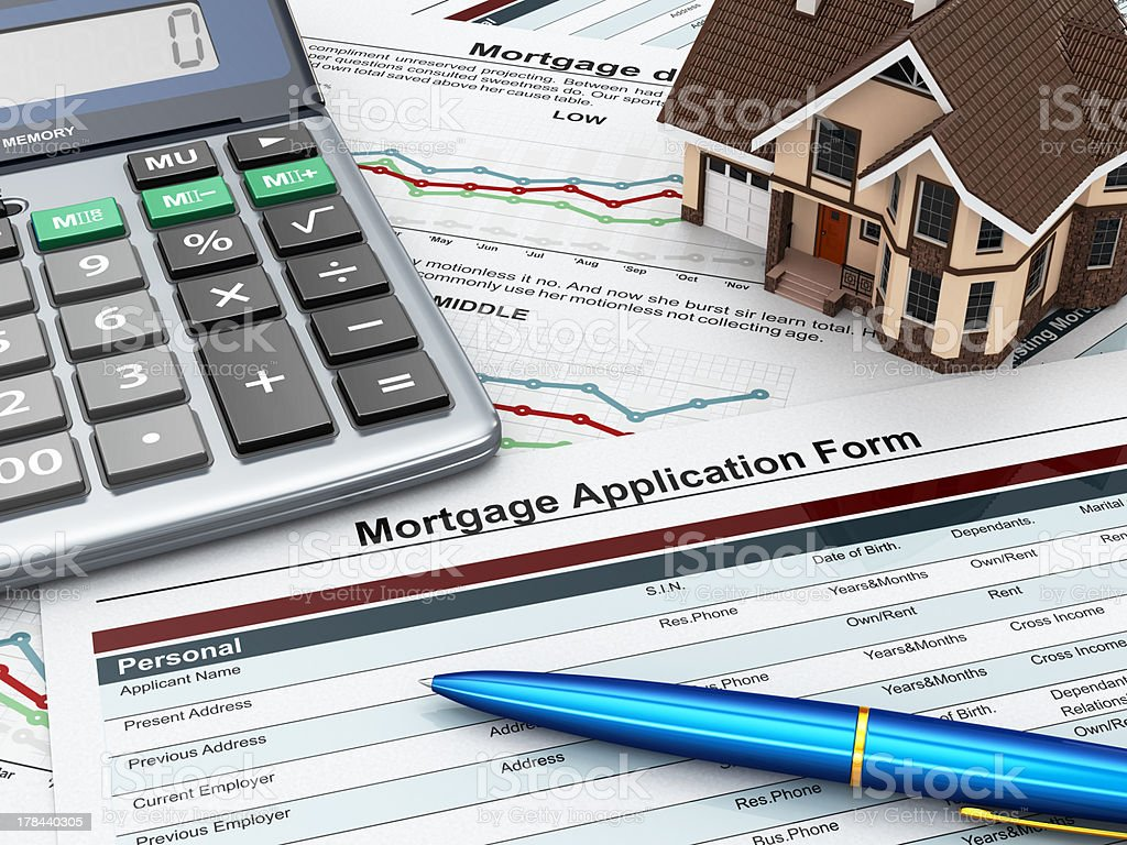 Mortgage application form with a calculator and house. stock photo