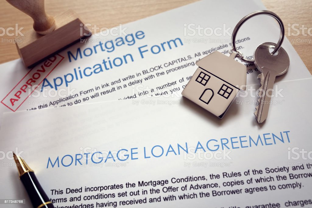 Mortgage application loan agreement and house key stock photo