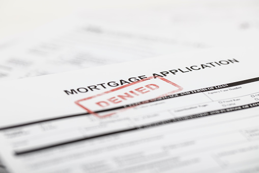A stock photo of a Mortgage application form with a red