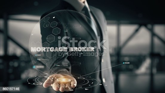 istock Mortgage Broker with hologram businessman concept 860157146