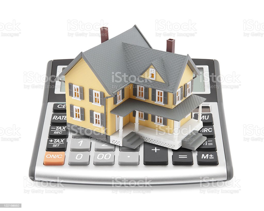 Mortgage calculator concept with little house building on it royalty-free stock photo