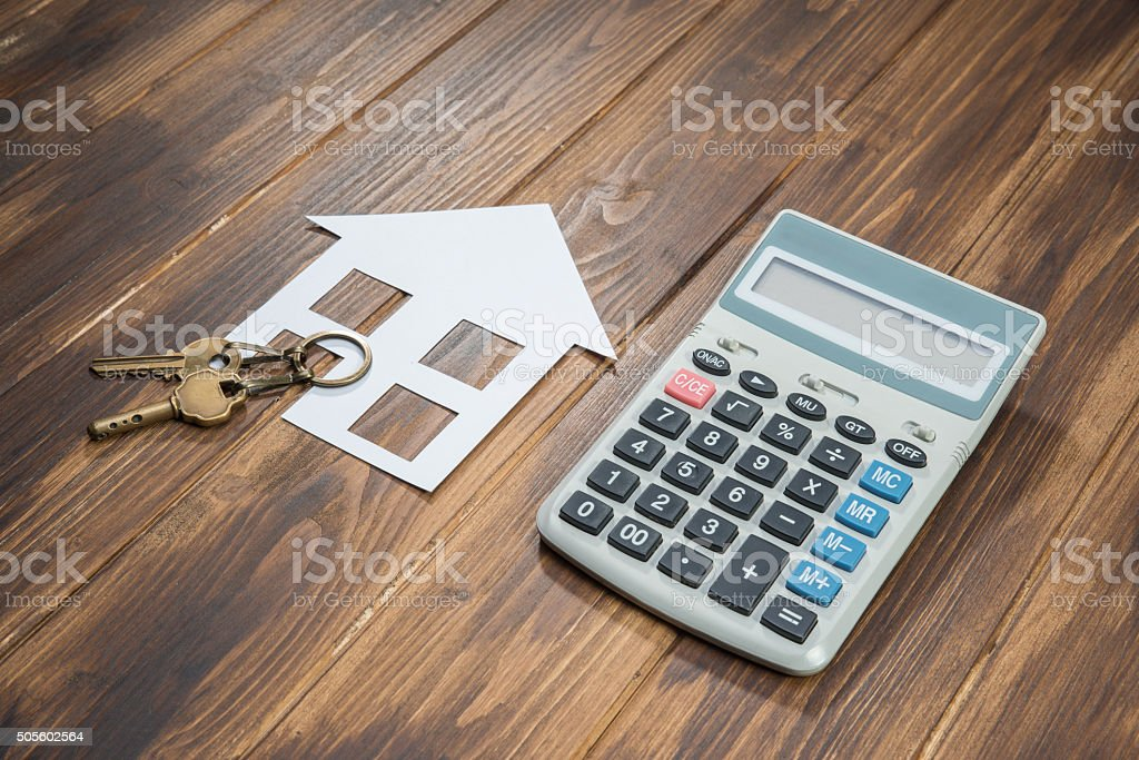 Mortgage Calculator, house and key with Calculator house and key with Calculator on wooden background Apartment Stock Photo