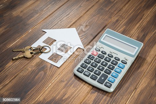 istock Mortgage Calculator, house and key with Calculator 505602564