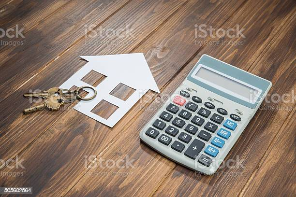 Mortgage Calculator House And Key With Calculator Stock Photo - Download Image Now
