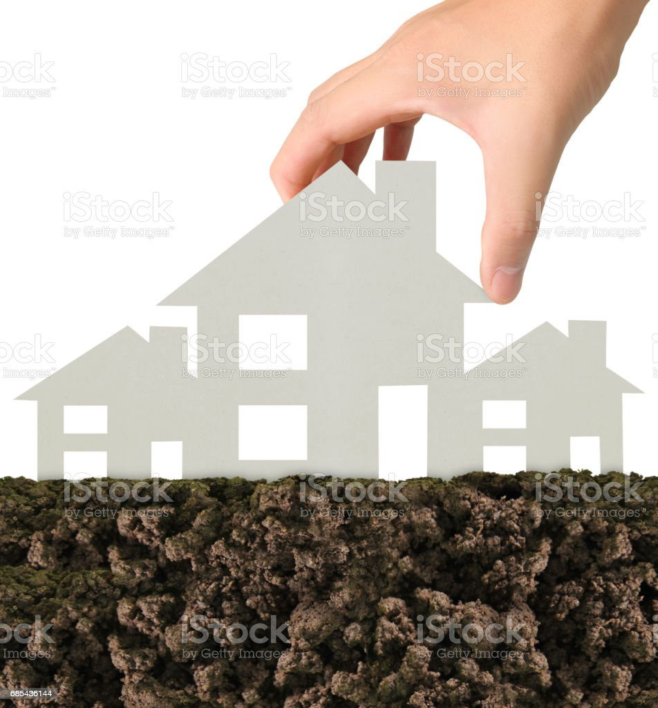 Mortgage concept by house from in  hand foto de stock royalty-free
