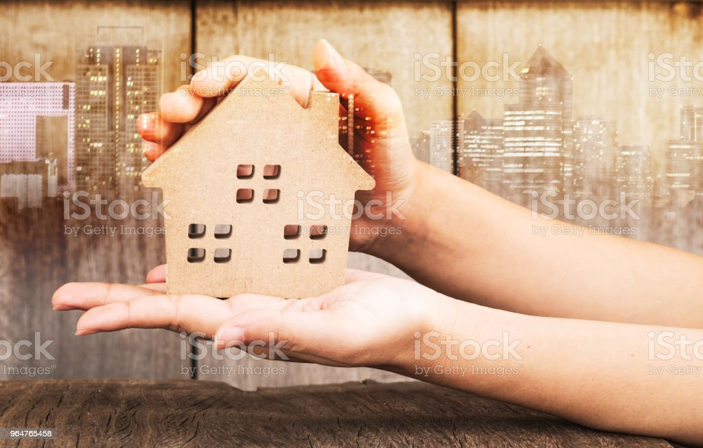 Mortgage concept by house from in hand royalty-free stock photo