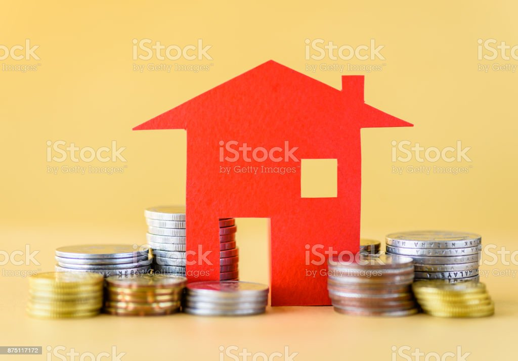 Mortgage concept by money house from the coins. Business finance and money saving concept. stock photo