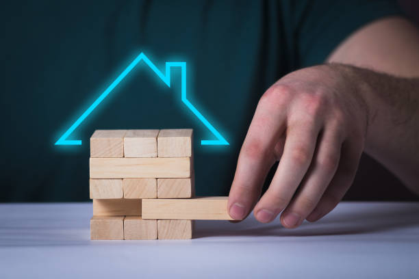 Mortgage concept wooden puzzle stock photo