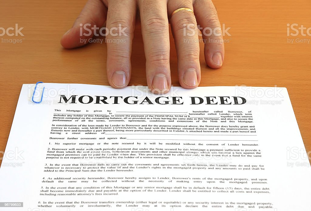 Mortgage Deed and Hand stock photo