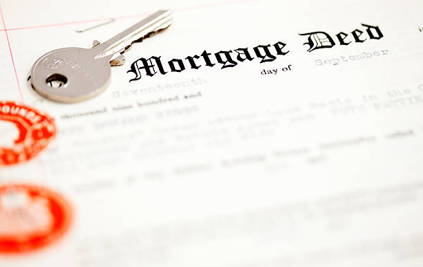 Mortgage deed document and key stock photo