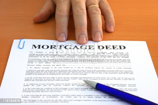 Male hand presents a mortgage document