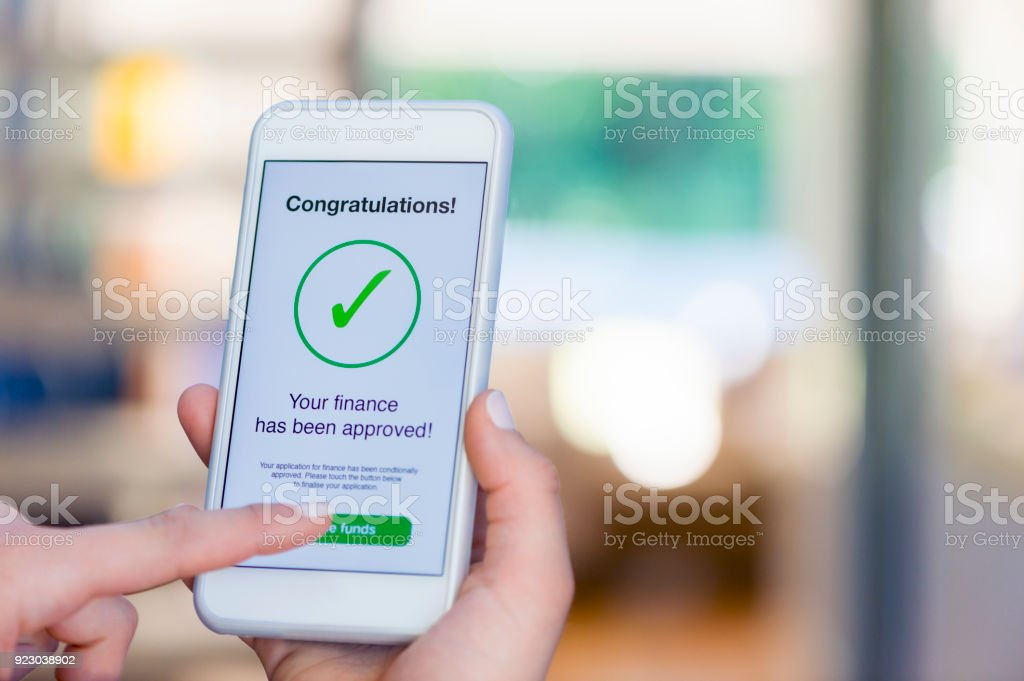 mortgage loan approval on mobile phone in a house stock