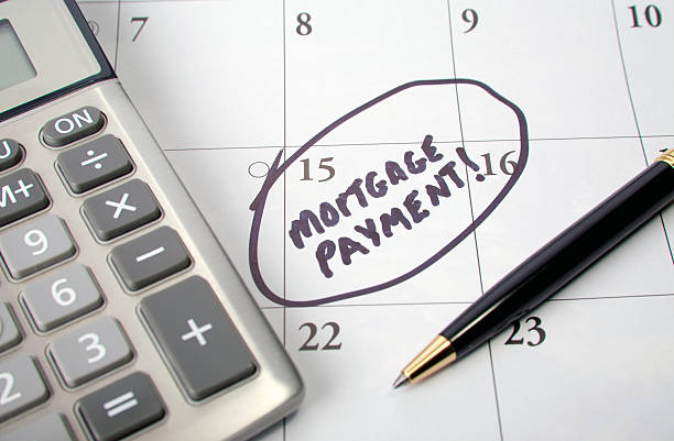 mortgage payment - mortgages and loans stock pictures, royalty-free photos & images