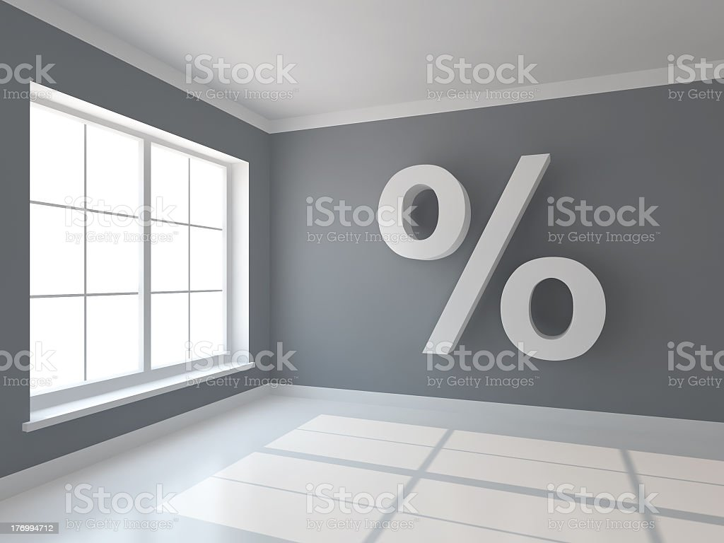 A mortgage percent on a grey background wall stock photo