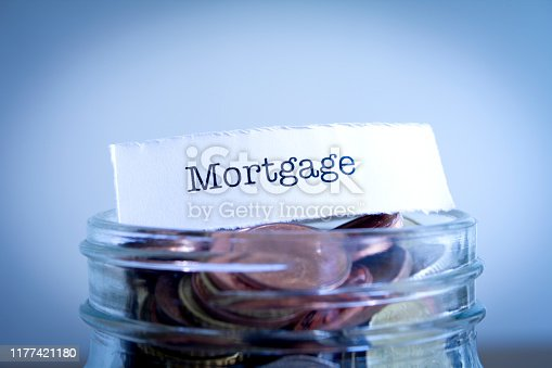 A close-up shot of the word Mortgage on a jar of coins.