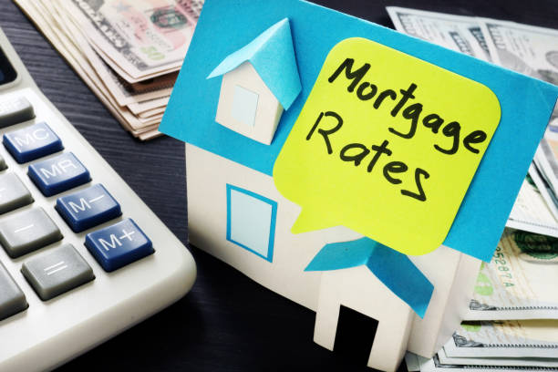Mortgage rates written on a model of house. Mortgage rates written on a model of house. mortgage loan stock pictures, royalty-free photos & images
