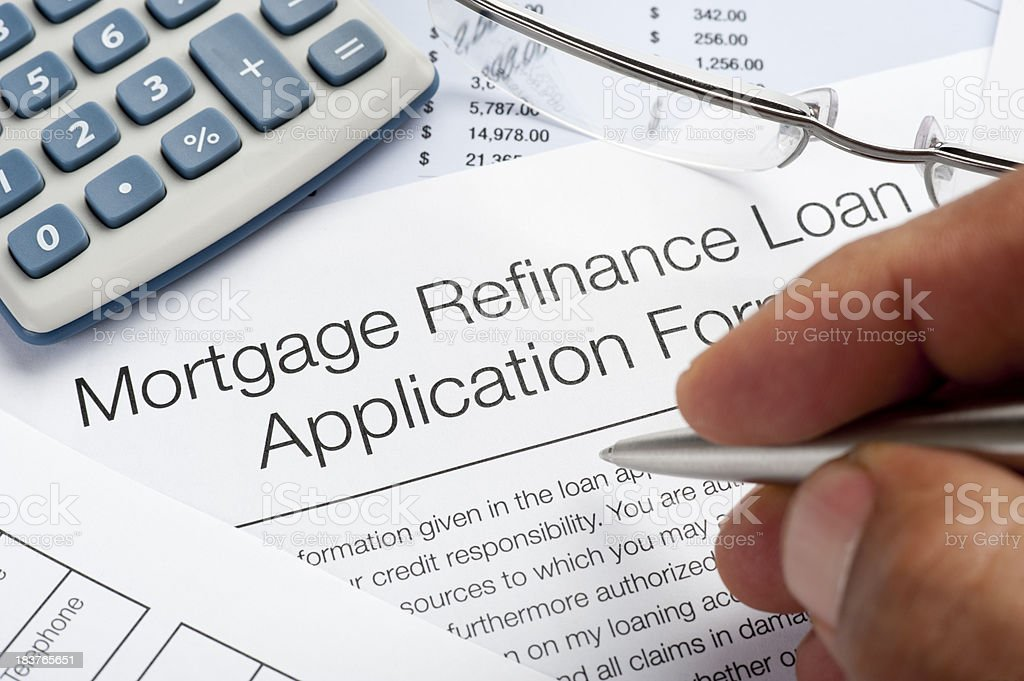 Mortgage Refinance Application Form with pen, calculator, writin stock photo