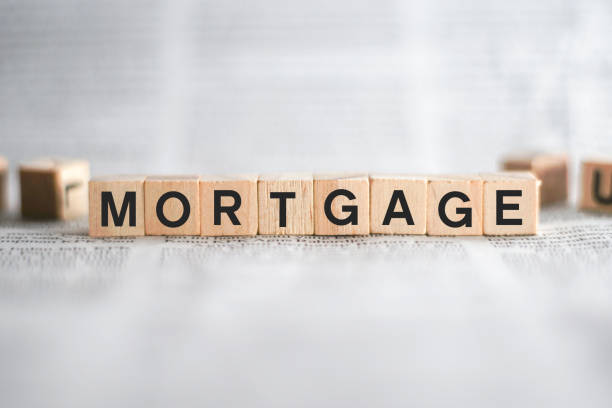 Mortgage Word Written In Wooden Cube stock photo