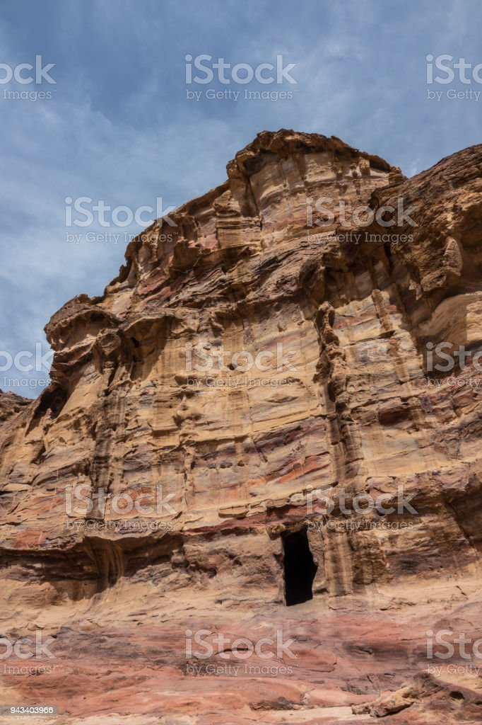 Mortuary cave carved in stone in Petra stock photo