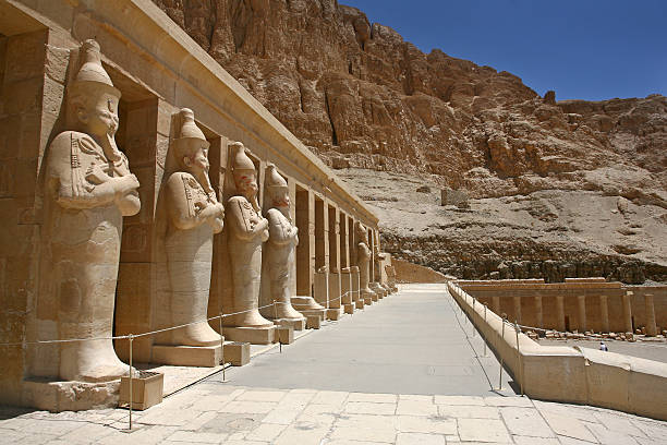 Mortuary Temple of Hatshepsut Egypt. Osiris Mortuary Temple of Hatshepsut, near the Valley of the Kings, in Luxor, Egypt. A row of statues of Queen Hatshepsut as Osiris valley of the kings stock pictures, royalty-free photos & images