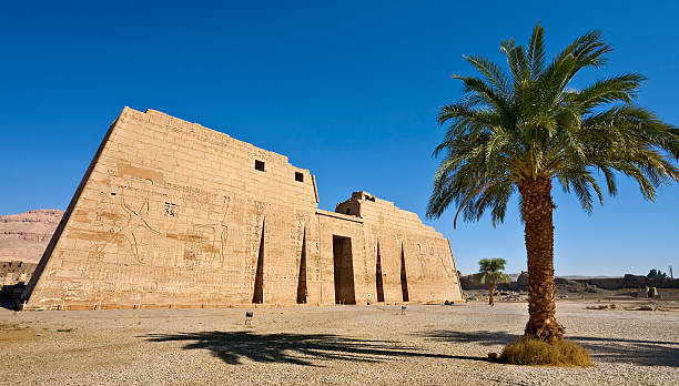 Mortuary Temple of Ramesses III Egypt. Luxor. Medinet Habu - the First Pylon of the Mortuary Temple of Ramesses III Tomb Of Ramses III stock pictures, royalty-free photos & images