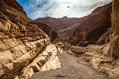 Mosaic Canyon in Death Valley National Park, a narrow canyon hike to a dry waterfall that floods during rains. The geology is formed by a fault line that bends the layers of sedimentary rock along with water erosion.
