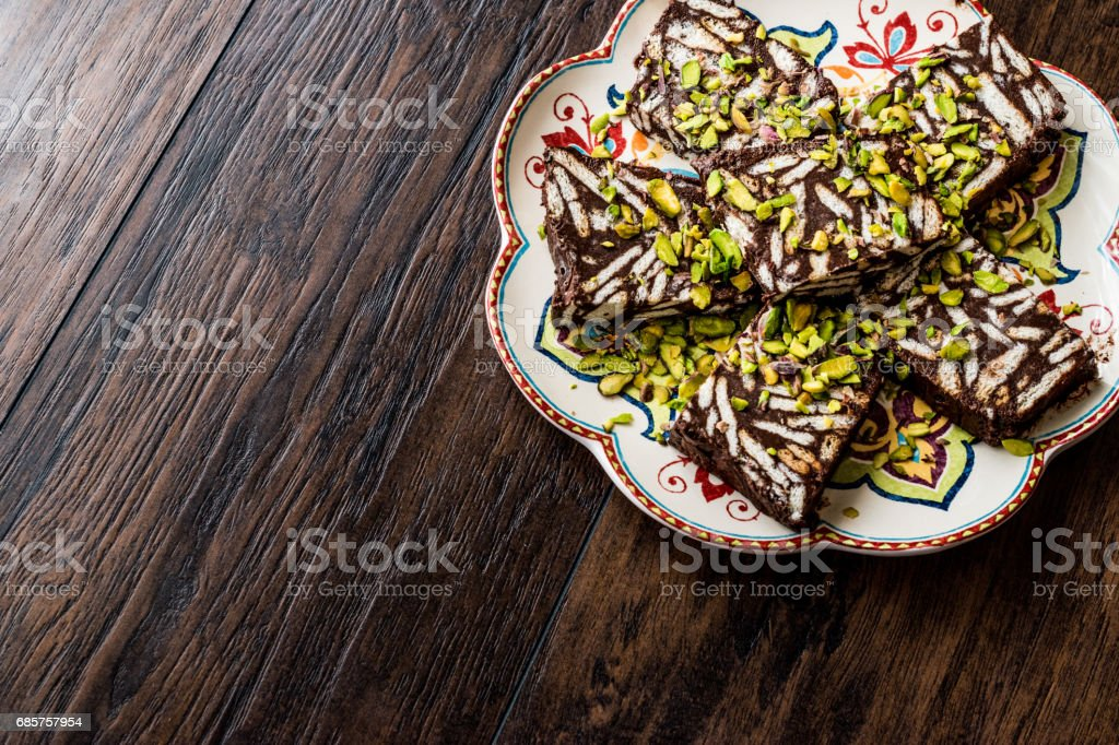 Mosaic Chocolate and Biscuit Cake with pistachio. royalty-free stock photo