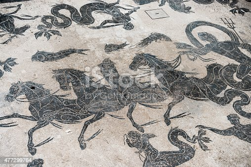 istock Mosaic detail on antique roman floor 477299764