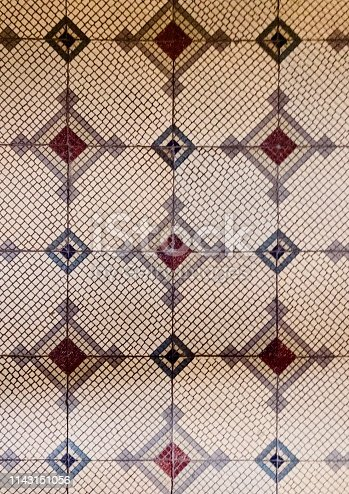 Geometric tiles laid as flooring on turn of the century apartment building in Mainz, Germany.