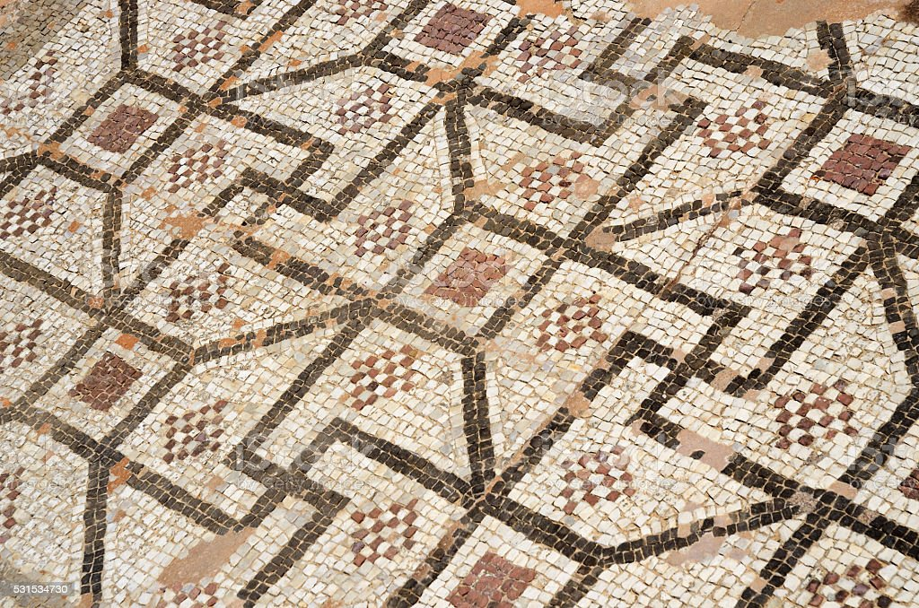 Mosaic floor with ancient geometrical ornament including fyflot symbol ,Cyprus stock photo